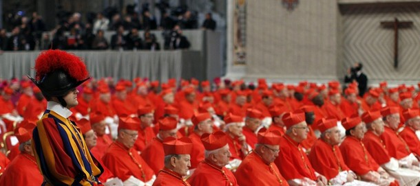 Incoming new Cardinals are seen during a consistory ceremony in Saint Peter's Basilica at the Vatican February 18, 2012. Pope Benedict XVI installed 22 new Roman Catholic cardinals from around the world on Saturday. REUTERS/Tony Gentile ( VATICAN - Tags: RELIGION)